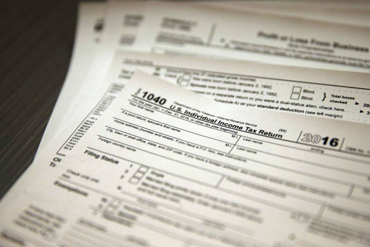 This year´s federal income-tax filing deadline is Tuesday, April 18. In this Jan. 14, 2017, photo, tax forms sit on a desk.