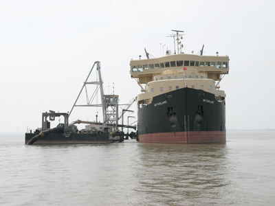 The Army Corps´ hopper dredge, the McFarland, unloads dredged material after doing maintenance dredging in the Delaware near Philadelphia.