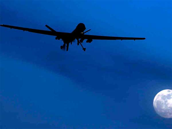 A U.S. Predator drone flying over southern Afghanistan. Predators are frequently used to attack militants in tribal areas of neighboring Pakistan, a practice the Pakistani government has threatened to halt. (AP File Photo)