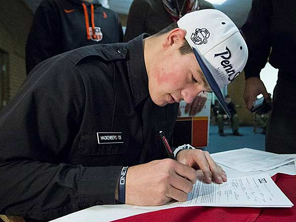 Christian Hackenberg, highly touted quarterback from Fork Union Military Academy in Virginia, signs his letter of intent to attend Penn State University. (Joe Hermitt/PennLive.com)