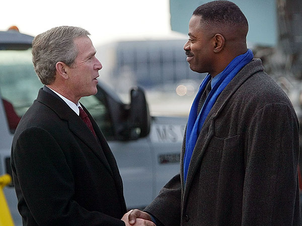 Former Eagles linebacker and current WIP radio co-host Garry Cobb, seen here with former president George W. Bush at Philadelphia International Airport, will announce his candidacy for a South Jersey Congressional seat Monday. (Pablo Martinez Monsivais/AP file photo)