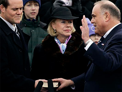 Ed Rendell, right, takes the oath of office for a second term in Harrisburg on Jan. 16, 2007. Holding the Bible are his son Jesse and wife Midge. (Carolyn Kaster / Associated Press)