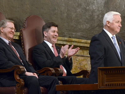 Pennsylvania Gov. Tom Corbett is flanked by Speaker of the House Sam Smith (left) and Lt.. Gov. Jim Cawley as he unveils his 2012-13 budget proposal before a joint session in the Pennsylvania State House Chamber on Tuesday. (Tom Gralish / Staff Photographer)