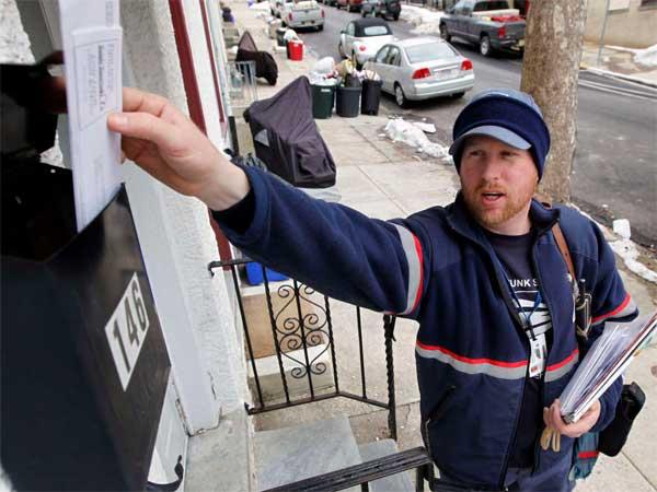 Kevin Pownall delivering mail in Philadelphia. (Matt Rourke / Associated Press)