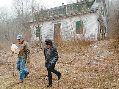 At her ancestral farm in Susquehanna County, settled in 1793, Denise Dennis strolls with caretaker John Arnone. Drillers have offered more than $800,000 for access to the Marcellus Shale. (TOM GRALISH / Staff Photographer)