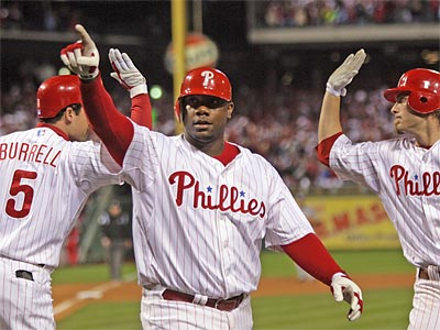 Ryan Howard has reason to celebrate after agreeing to a 3-year, $54 million deal with the Phillies that will allow both sides to avoid arbitration. (Yong Kim/Staff Photographer)