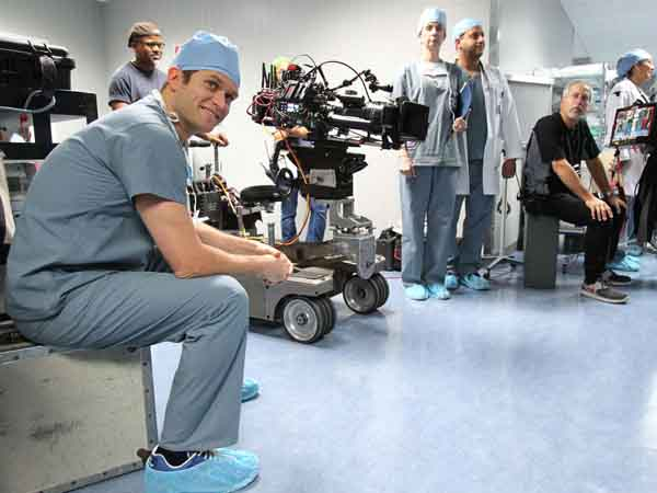"Steven Pasquale, left, stars in the upcoming NBC series ""Do No Harm"", a modern Dr. Jekyll and Mr Hyde.  The show is being filmed in Philadelphia. An empty floor in the Philadelphia School District´s building at 440 N. Broad St. was converted into a hospital.  Pasquale takes a break between scenes.  ( Charles Fox / Staff Photographer )"