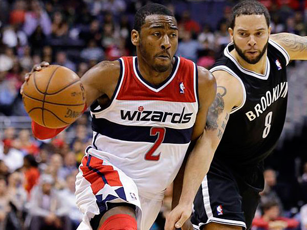 Wizards guard John Wall (2) drives past Brooklyn Nets guard Deron Williams (8) during the second half of an NBA basketball game Friday, Feb. 8, 2013, in Washington. (Alex Brandon/AP)