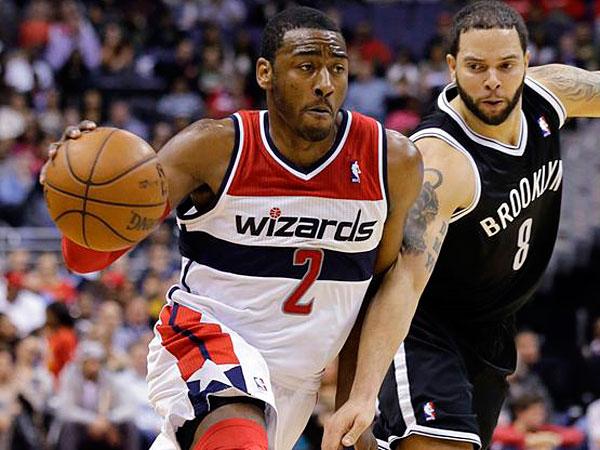Wizards guard John Wall (2) drives past Brooklyn Nets guard Deron Williams (8) during the second half of an NBA basketball game Friday, Feb. 8, 2013, in Washington. (Alex Brandon/AP)