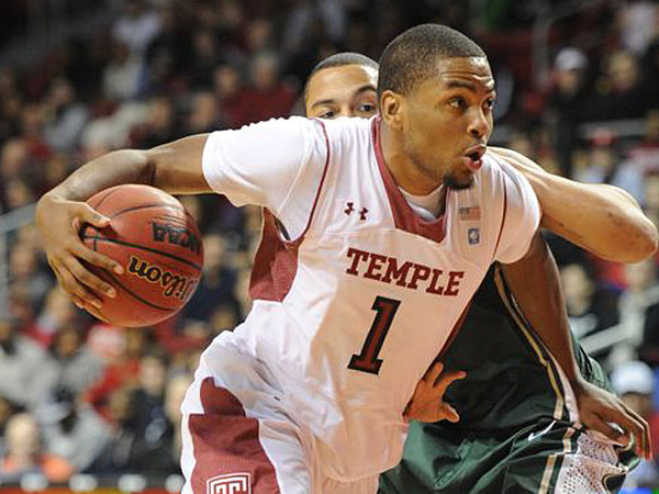 Temple&acute;s Khalif Wyatt drives around Charlotte&acute;s Pierria&acute; Henry and<br />goes in for a layup during second half action Feb. 6, 2013 at Temple. <br />Temple won the close game 89-88. (Clem Murray/Staff Photographer)<br />