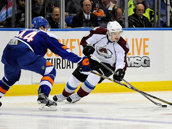 The Avalanche´s Matt Duchene, right, controls the puck against New York Islanders´ Calvin de Haan (44) in the third period of an NHL hockey game on Saturday, Feb. 8, 2014, in Uniondale, N.Y. Duchene scored two goals during the Avalanche´s 4-2 win. (Kathy Kmonicek/AP)