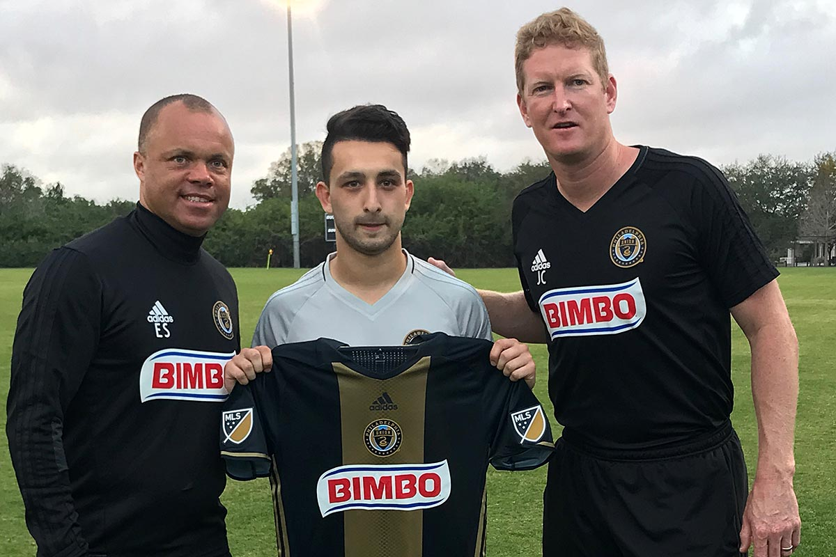New Philadelphia Union midfielder Adam Najem (center) poses for a picture with sporting director Earnie Stewart (left) and head coach Jim Curtin (right) after his signing was announced.