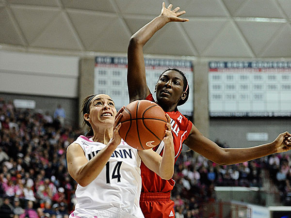Connecticut´s Bria Hartley drives to the basket as Louisville´s Asia Taylor defends. (Jessica Hill/AP)