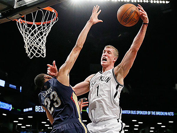 Nets forward Mason Plumlee is fouled by Pelicans forward Anthony Davis. (Paul J. Bereswill/AP)
