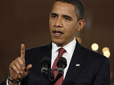 President Barack Obama pressed Congress to pass an economic stimulus package in his prime-time news conference Monday night. (Charles Dharapak/AP)