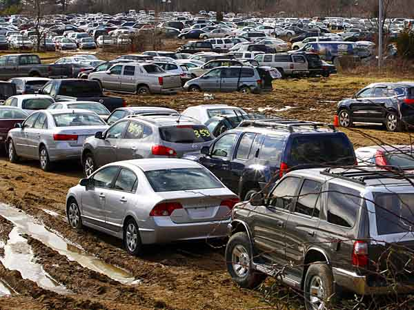 In this Friday, Feb. 1, 2013 photograph, thousands of storm-damaged and water-logged cars, ruined by Superstorm Sandy, are parked in a 22-acre field in Mansfield, N.J. Officials in the southern New Jersey town say the facility there cannot continue to store 2,400 cars damaged in Superstorm Sandy. The Mansfield Zoning Board of Adjustment declined Monday to grant a variance to Vanco, a truck trailer manufacturer that wanted to continue storing the cars for Copart, a Dallas-based firm that buys and auctions salvaged cars. (AP Photo/Mel Evans)