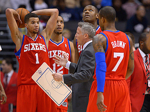 76ers head coach Brett Brown talks to his team as Lavoy Allen looks up toward the scoreboard and Michael Carter-Williams, Evan Turner and Lorenzo Brown look on. (Mark J. Terrill/AP)