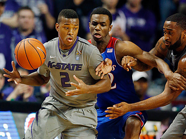 Kansas State guard Marcus Foster tries to go around Kansas guard Andrew Wiggins. (Orlin Wagner/AP)