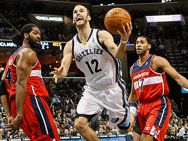 Grizzlies guard Nick Calathes goes to the basket between Wizards forward Nene and guard Garrett Temple. (Lance Murphey/AP)