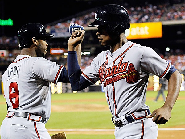 The Braves´ B.J. Upton celebrates with Justin Upton. (Michael Perez/AP)