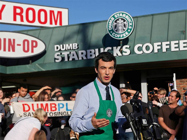 "Canadian comedian Nathan Fielder of the Comedy Central show ""Nathan For You"" comes forward as the brainchild of ""Dumb Starbucks,"" a parody store that resembles a Starbucks with a green awning and mermaid logo, but with the word ""Dumb"" attached above the Starbucks sign. Starbucks Coffee spokeswoman, Laurel Harper says the store is not affiliated with Starbucks and, despite the humor, the store cannot use the Starbucks name. (AP Photo/Nick Ut)"