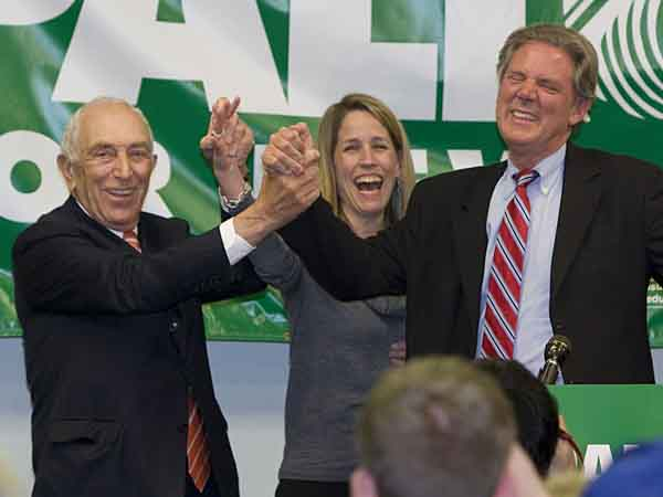 Rep. Frank Pallone, right, D-N.J., celebrates with Sen. Frank Lautenberg, D-N.J., and Pallone´s wife, Sarah, after winning re-election, Tuesday, Nov. 2, 2010, in Red Bank, N.J. (AP Photo/Asbury Park Press, Bob Bielk)