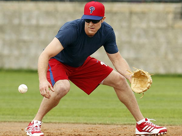 Phillies Chase Utley fields a ground ball during Spring Training workouts in Clearwater, FL on Tuesday, February 12, 2013. (Yong Kim/Staff Photographer)