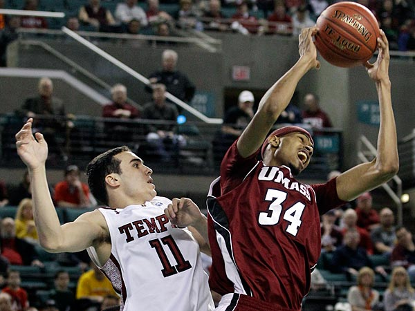 Massachusetts´ Raphiael Putney (34) pulls in a rebound in front of Temple´s T.J. DiLeo (11) during the first half of a quarterfinals NCAA college basketball game at the Atlantic 10 tournament in Atlantic City, N.J., Friday, March 9, 2012. (AP Photo/Mel Evans)