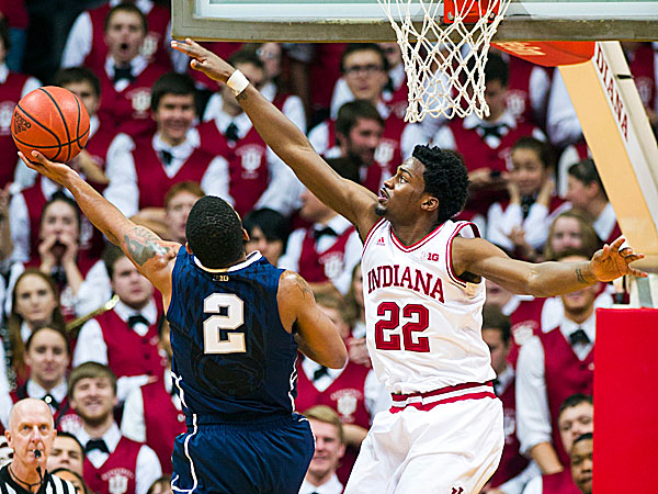 Indiana´s Stanford Robinson stretches out in an effort to block the shot of Penn State´s D.J. Newbill. (Doug McSchooler/AP)