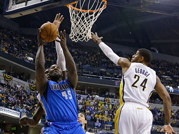 Mavericks center DeJuan Blair, left, shoots next to Indiana Pacers forward Paul George during the first half of an NBA basketball game in Indianapolis, Wednesday, Feb. 12, 2014. (Michael Conroy/AP)