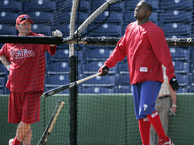 Phillies first baseman Ryan Howard watches the flight of a ball as he takes batting practice at Bright House Field Friday morning in Clearwater. (Eric Mencher / Staff Photographer)