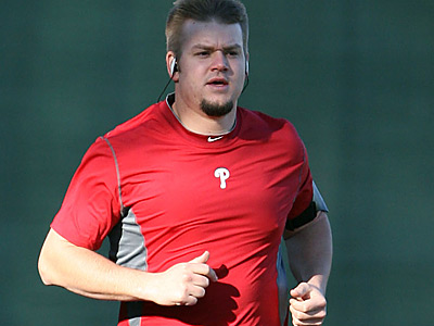 Joe Blanton takes a jog around the warning track at Bright House Field in Clearwater. (Yong Kim/Staff Photographer)