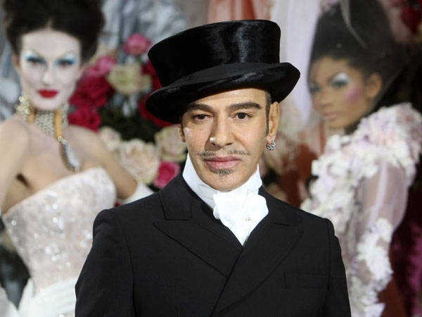 FILE - In this Jan. 25, 2010 file photo, fashion designer John Galliano poses at the end of the presentation of the Dior Haute Couture spring/summer 2010 fashion collection in Paris. Galliano landed on the front of the New York Post on Wednesday, Feb. 13, 2013, with a photo of the designer wearing a hat and ringlets described as resembling those of a Hasidic Jew. Galliano was fired from Christian Dior two years ago after his anti-Semitic rant was caught on video, and the tabloid said the outfit ìignited a new round of outrage.î (AP Photo/Jacques Brinon, file)