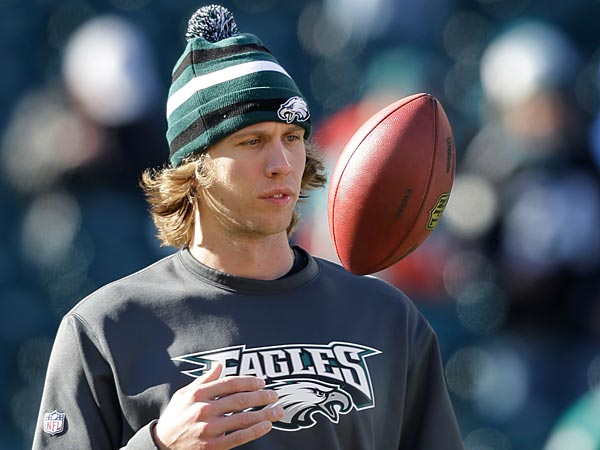 Philadelphia Eagles quarterback Nick Foles tosses the ball as he warms up before an NFL football game against the Washington Redskins, Sunday, Dec. 23, 2012, in Philadelphia. (AP Photo/Mel Evans)