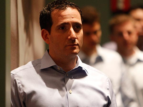 Eagles&acute; general mManager Howie Roseman, left, listens to head coach Chip Kelly speak as the Eagles introduce the new members of their<br />coaching staff at the NovaCare Complex in Philadelphia, Pa. on<br />February 11, 2013. ( DAVID MAIALETTI / Staff Photographer )