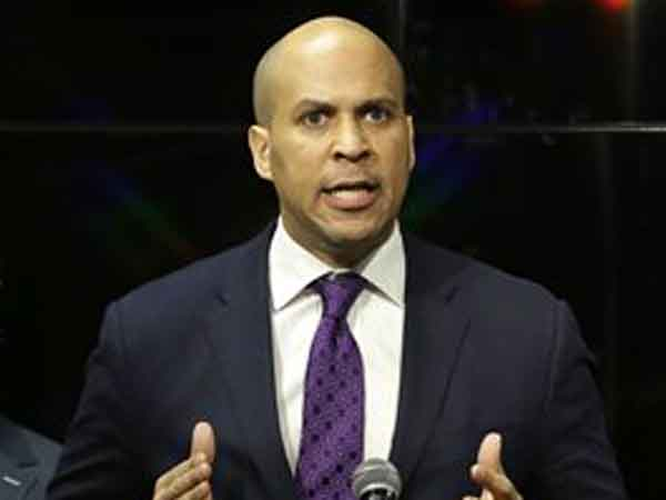 Newark Mayor Cory Booker responds at a news conference, Wednesday, Feb. 13, 2013 in Newark.  (AP Photo/Mel Evans)