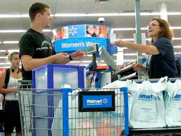Shoppers move through a Wal-Mart checkout line in Tallahassee, Fla. (Phil Coale / Associated Press)