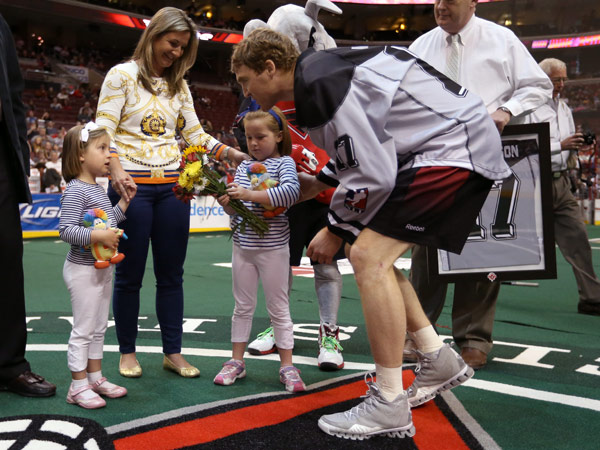 Brodie Merrill greets the family of Chris Sanderson: Wife Brogann and daughters Clementine and Stevie. (Wings photo)