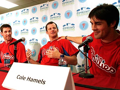 Cole Hamels jokes with Roy Oswalt as Cliff Lee looks on. (Yong Kim/Staff Photographer)