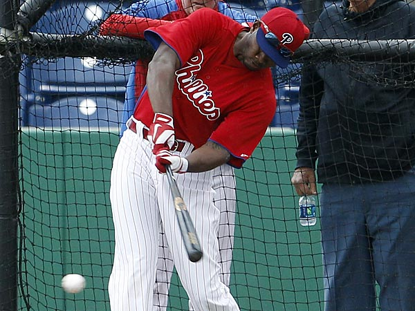 Phillies outfielder Domonic Brown takes batting practice as manager Charlie Manuel and special adviser Dallas Green watch during spring training in Clearwater on Thursday, February 14, 2013. (Yong Kim/Staff Photographer)
