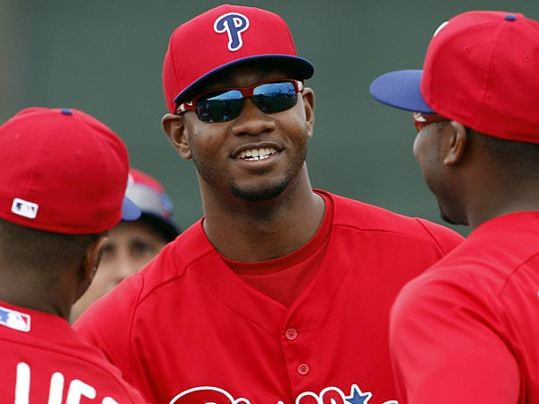 Phillies outfielder Domonic Brown (center) stands next to teammates Ryan Howard and Zach Collier during spring training in Clearwater on Thursday, February 14, 2013. (Yong Kim/Staff Photographer)