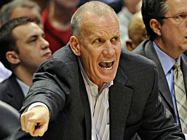 Doug Collins yells to his team as they play the Milwaukee Bucks during the first half of an NBA basketball game on Wednesday, Feb. 13, 2013, in Milwaukee. (Jim Prisching/AP)