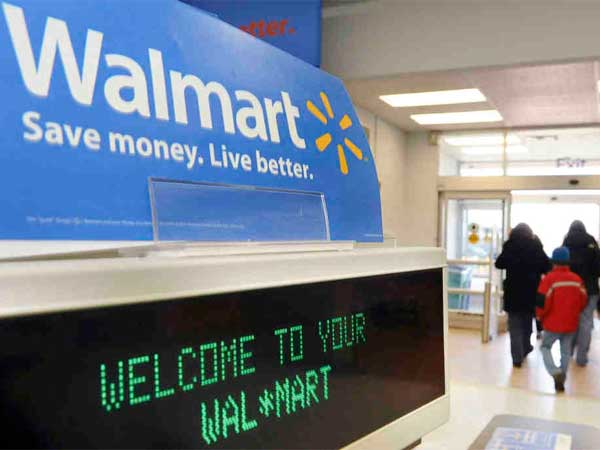 Walmart stores aim to boost store traffic, but the company also is pushing to raise online sales. (Lisa Poole / Associated Press)