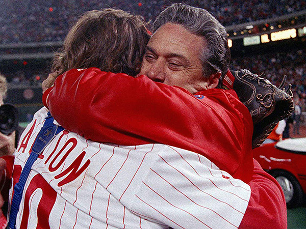 Jim Fregosi (right), hugs Darren Daulton after the Phillies won the 1993 National League Championship Series. (Amy Sancetta/AP file photo)