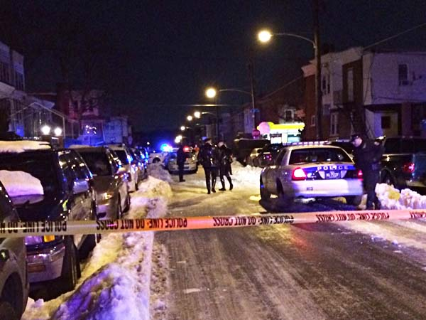 Police investigate a fatal shooting on Rockland Street near C in Feltonville Friday, February 14, 2014. (Vinny Vella / Daily News Staff