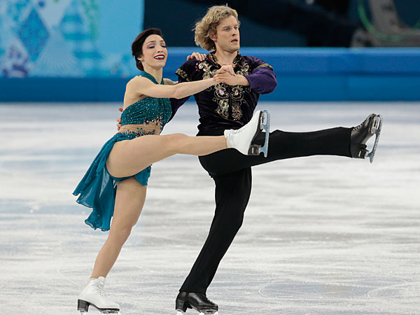Meryl Davis and Charlie White of the United States compete in the team free ice dance figure skating competition at the Iceberg Skating Palace during 2014 Winter Olympics, Sunday, Feb. 9, 2014, in Sochi, Russia. (Ivan Sekretarev/AP)
