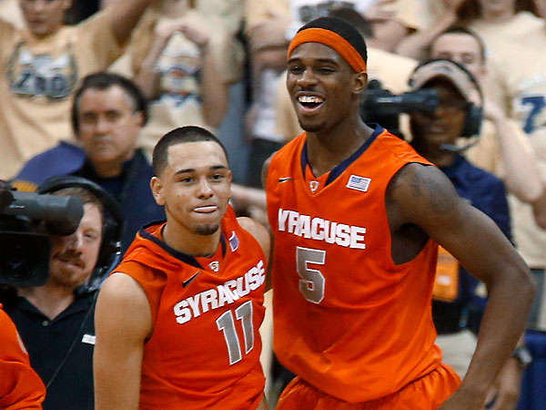 Syracuse´s Tyler Ennis (11) celebrates with C.J. Fair (5) after hitting a 3-point shot with less than a second remaining in an NCAA college basketball game against Pittsburgh on Wednesday, Feb. 12, 2014, in Pittsburgh. Syracuse won 58-56. (Keith Srakocic/AP)