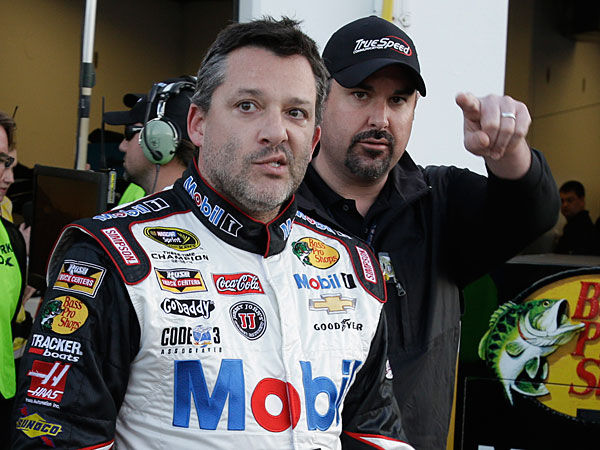 Tony Stewart walks from his garage after practice for the Sprint Unlimited auto race at Daytona International Speedway in Daytona Beach, Fla., Friday, Feb. 14, 2014. (John Raoux/AP)