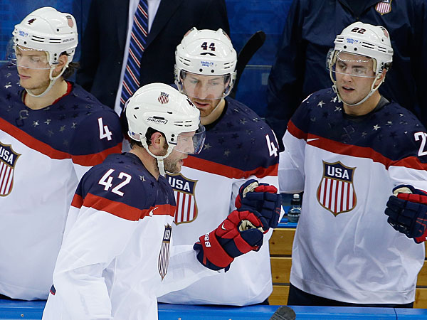 USA forward David Backes celerates his goal against Slovakia with his teammates on the bench during the 2014 Winter Olympics men´s ice hockey game at Shayba Arena, Thursday, Feb. 13, 2014, in Sochi, Russia. (Matt Slocum/AP)