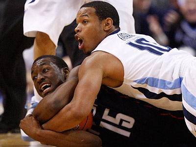 Corey Fisher and UConn´s Kemba Walker battled for a loose ball during the first half. (Ron Cortes/Staff Photographer)